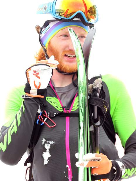 Crested Butte's Cam Smith chats with fellow racers after taking second in the 2019 Audi Power of Four ski mountaineering race on Saturday, March 2, 2019, in Aspen. (Photo by Austin Colbert/The Aspen Times).