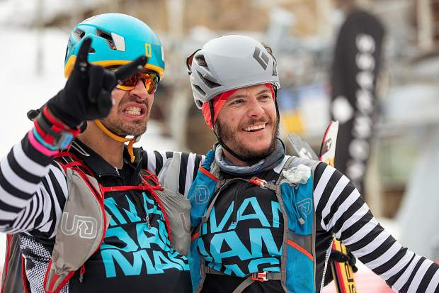 Anders Mavis, left, and teammate William Golde pose for a photo at the base of Aspen Mountain after completing the Power of Four.