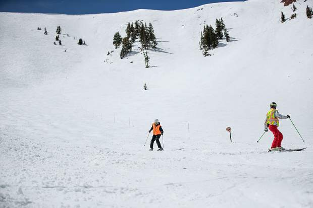 Blind skier and adventurer Erik Weihenmayer skis down Highland Bowl on April 9 with direction from blind ski guide Rob Leavitt.
