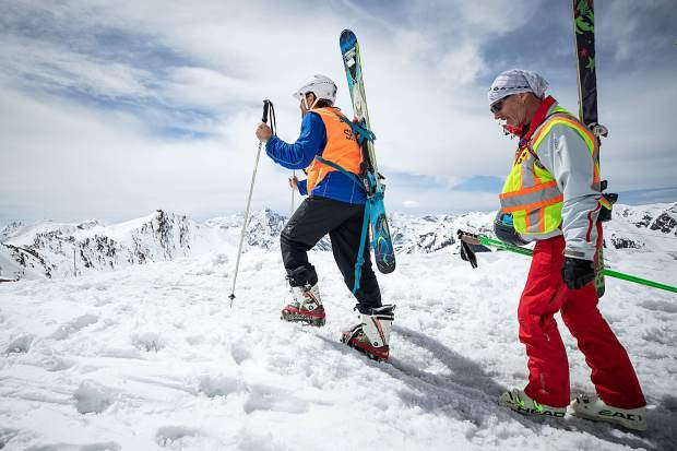 Blind skier and adventurer Erik Weihenmayer hikes Highland Bowl with blind skier guide Rob Leavitt assisting with direction on April 9.
