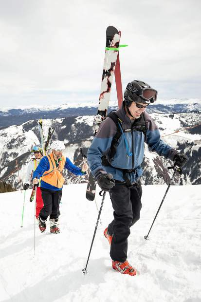 Blind skier and adventurer Erik Weihenmayer hikes Highland Bowl with blind skier guide Rob Leavitt assisting with direction and Aspen Times reporter Scott Condon leading with a bell on his ski pole on April 9.