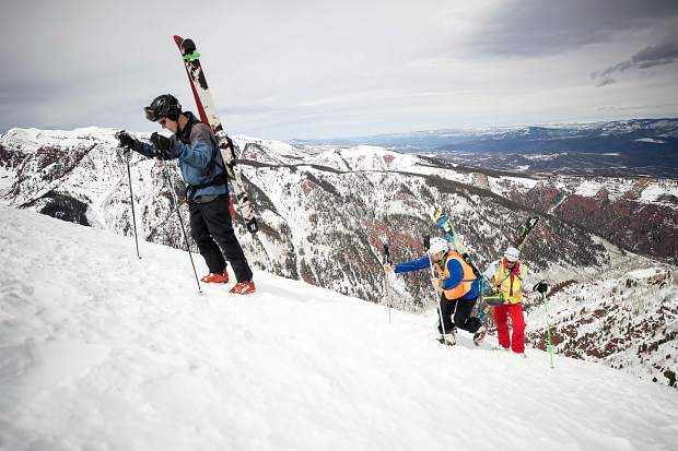 Blind skier and adventurer Erik Weihenmayer, center, hikes Highland Bowl with blind skier guide Rob Leavitt assisting with direction and Aspen Times reporter Scott Condon leading with a bell on his ski pole on April 9.