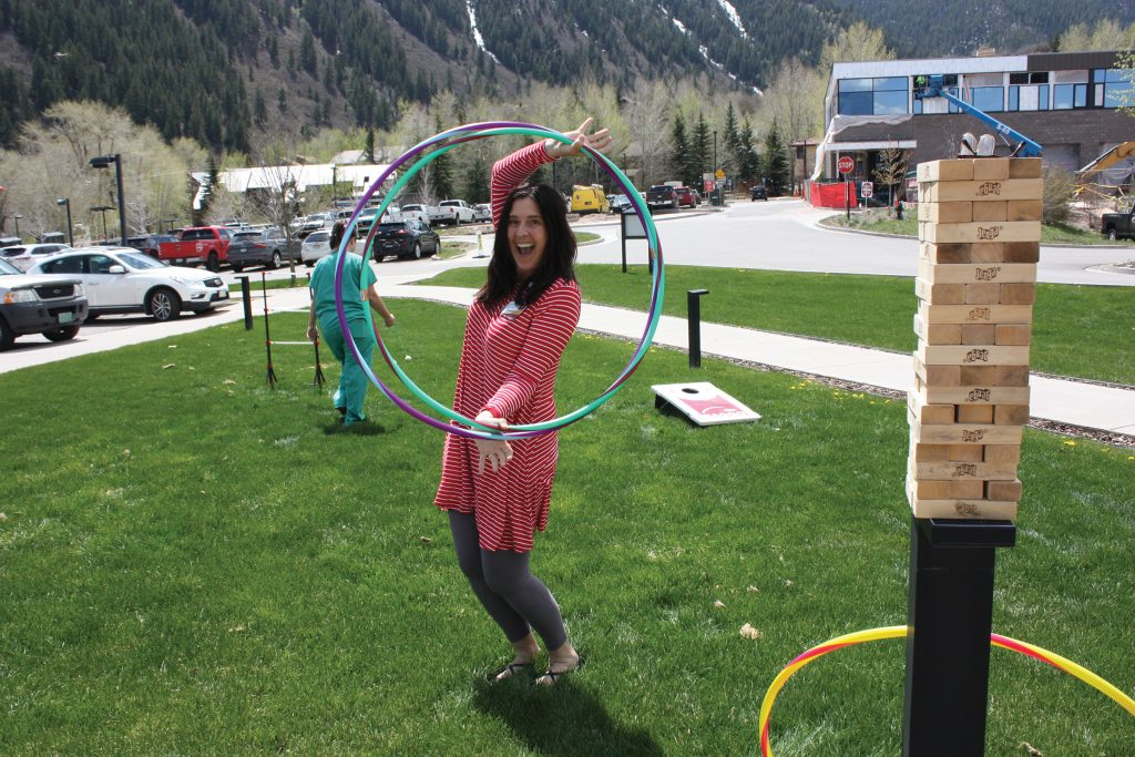 Andrea Olson from the Foundation learns to hula hoop.