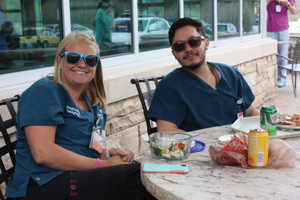Paige Nehasil and Oscar Garcia from Diagnostic Imaging enjoy lunch.