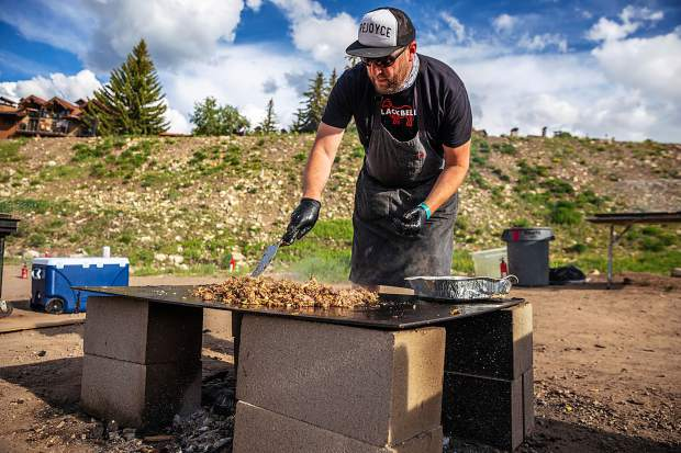 Top Chef season 5 winner Hosea Rosenberg of Boulder's Blackbelly prepares food at Heritage Fire in Snowmass.