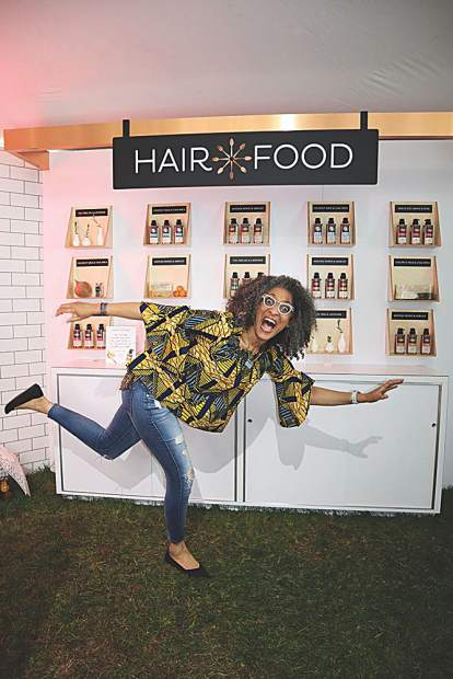 Chef, TV personality and former model Carla Hall reenacts the spill she took on stage last year as host of the 2018 James Beard Awards in Chicago.