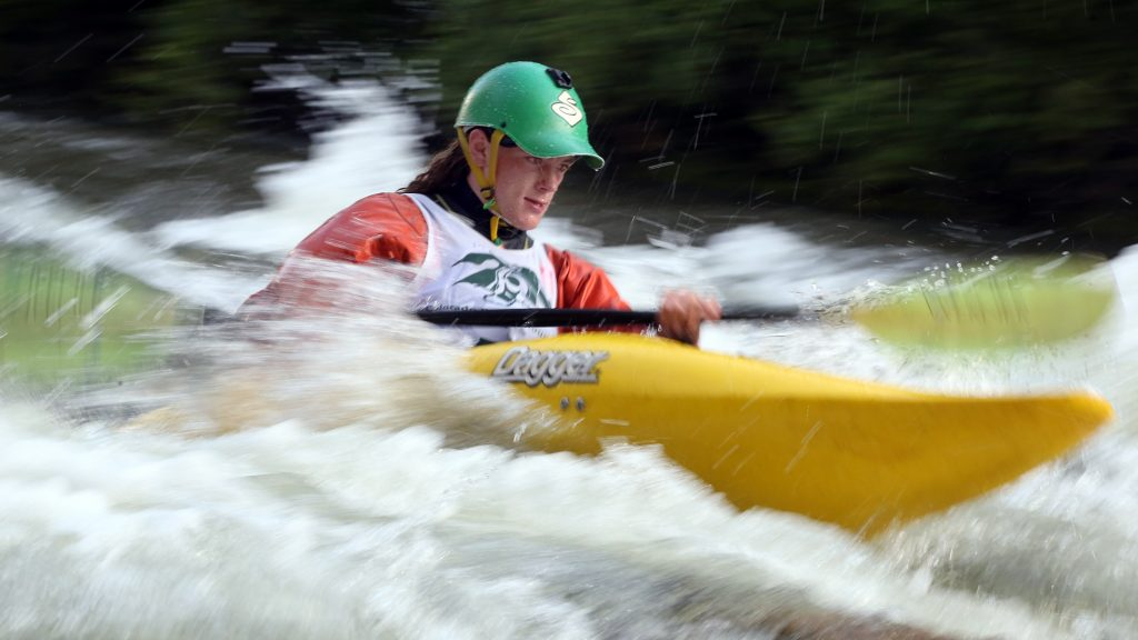 A kayaker goes through some rapids on the Roaring Fork River during the fifth annual Slaughter Fest race on Friday, July 12, 2019. The race, for kayakers, rafters or the daring stand-up paddleboarder, started at Henry Stein Park and finished at Jaffee Park in Woody Creek. (Photo by Austin Colbert/The Aspen Times)