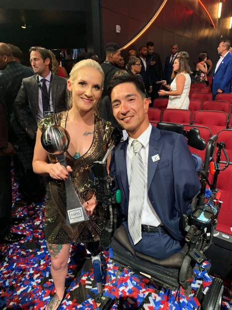 Kirstie Ennis is pictured here with the Jimmy V Award for Perseverance winner, Rob Mendez.
