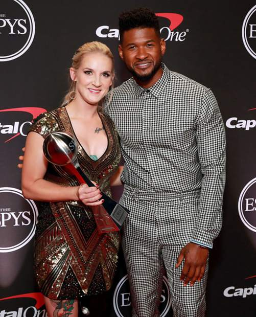 Former Marine Sergeant and current Ironbridge resident Kirstie Ennis received the Pat Tillman Award at the 2019 ESPYs in Los Angeles Wednesday night. Ennis is pictured here with the award and the award's presenter, Usher.