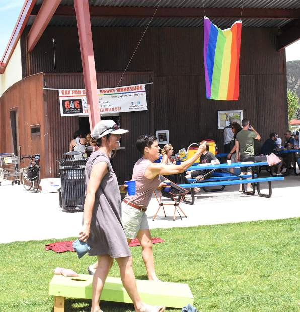 Wendy Kennedy, foreground, and Stacey Baldock play a game of cornhole at the Gay 4 Good Rocky Mountain chapter first-year anniversary celebration picnic Saturday at Crown Mountain Park in El Jebel.