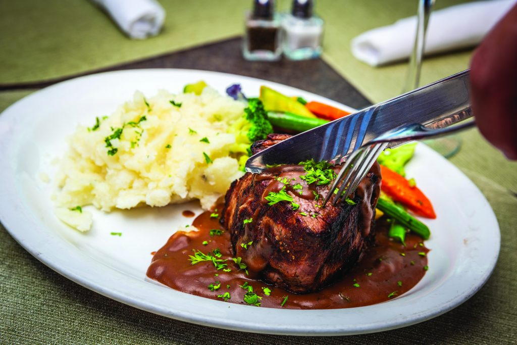 Filet Mignon Bordelaise with mashed potatoes and assorted fresh vegetables