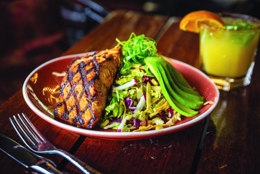 The salmon salad is a light, refreshing summer dish with a vinaigrette that is avocado based