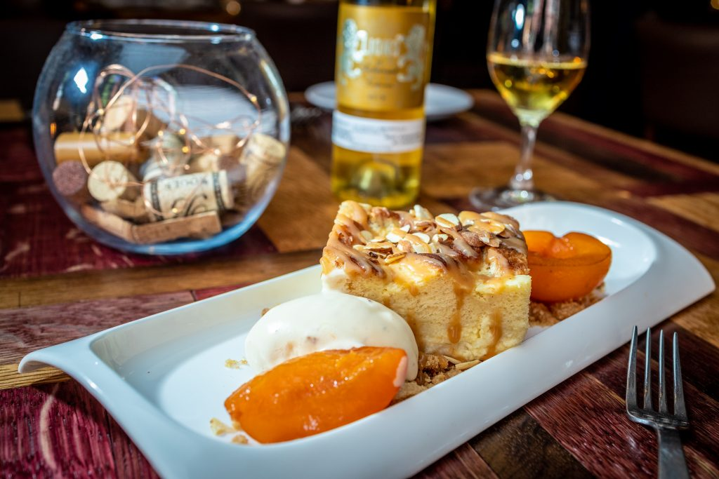 Bread pudding, compressed apricots, creme fraiche ice cream, almonds