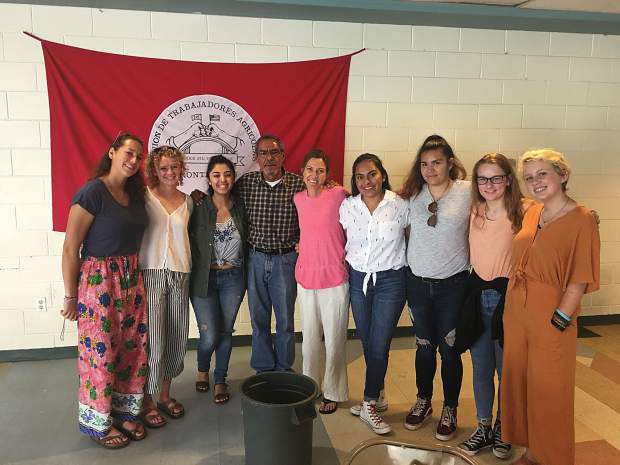At Sin Fronteras Farm Worker's Center: from left to right: Nicole Peirson, Fiona Ritchie, an intern from Duke University who works at the farm worker's center, Carlos Merentes, Michelle Skagen, Carla Soto Michelle Guererro, Gabriela Silva, Carolina Robinson, Tilly Swanson