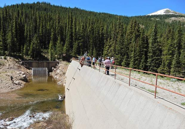Attendees of a tour organized by Roaring Fork Conservancy visit the dam on the Roaring Fork River near Lost Man Campground on Friday. Few people realize there is a major dam on the river less than one-half mile from Highway 82.