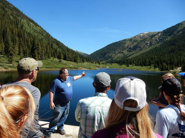Kevin Lusk, pointing, describes the water diversion system in the Upper Roaring Fork River basin Friday while visiting Lost Man Reservoir. Roaring Fork Conservancy hosted a public tour of the diversion system.