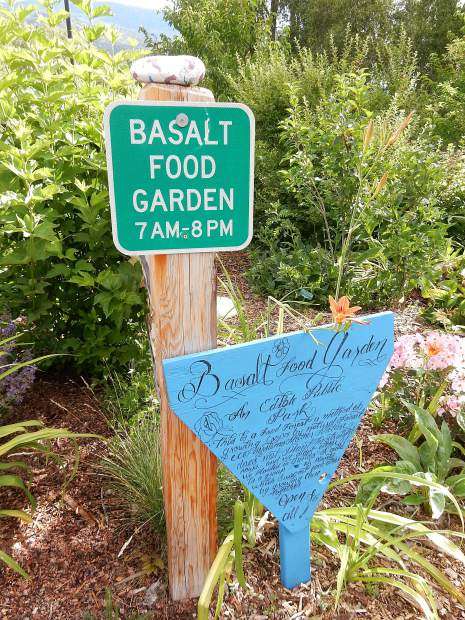 The public is invited to taste the offerings at Basalt's edible garden. 'Open to all,' the bottom sign says.