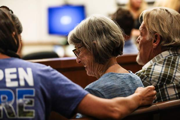 Andee McCauley, center, who lost her home in the Lake Christine Fire, gets comfort from friend Jocelyn Terry during a sentencing hearing Monday. Bill McCauley is on the right.