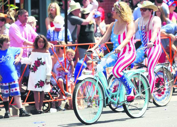 People take part in the 2018 Fourth of July parade in Aspen.
