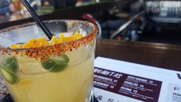 The spicy orange margarita at Venga Venga is one of a handful on the colorful marg menu.