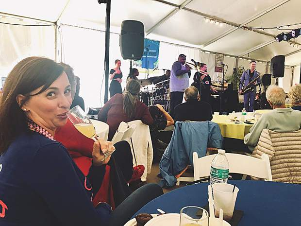 Katherine Roberts sips a Mimosa as she takes in the sounds of the Jazz Aspen Snowmass New Orleans Jazz Brunch on June 23.