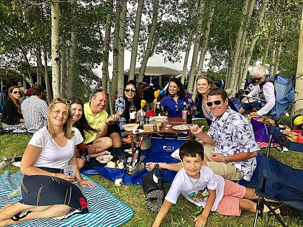 The Aspen Festival Orchestra at the Benedict Music Tent: Charlotte Porter, Liz Landry, Danny Danko, MC Vaughn, Diane Henry, Heidi Kowar and Danny Becker take in the first Sunday concert on the lawn on June 30.