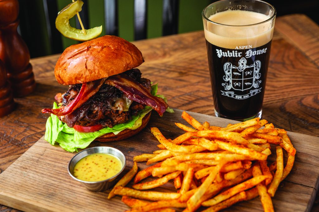 Public House double stack: two, 4oz patties, secret sauce, caramelized onions, shredded lettuce, American cheese, brioche bun
