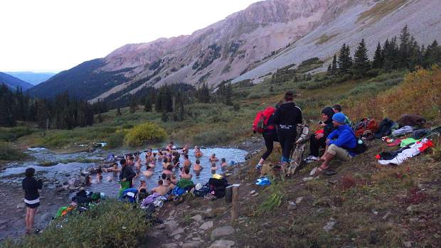 The party scene at the Conundrum Hot Springs use to attract up to 300 people on summer weekends, as shown by this undated photo. The Forest Service implemented an overnight visits management plan in summer 2018.