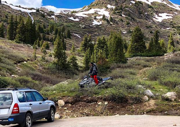 A snowmobiler picks his way down fragile, snow-free terrain to the Upper Lost Man Trailhead on July 3. Snowmobiles weren't allowed in the wilderness even if there was snow.