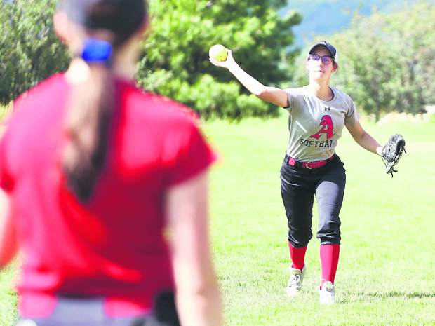 Aspen High senior Laney Martens throws during warm up at practice on Thursday, Aug. 15, 2019 at Upper Moore Field. (Photo by Austin Colbert/The Aspen Times)