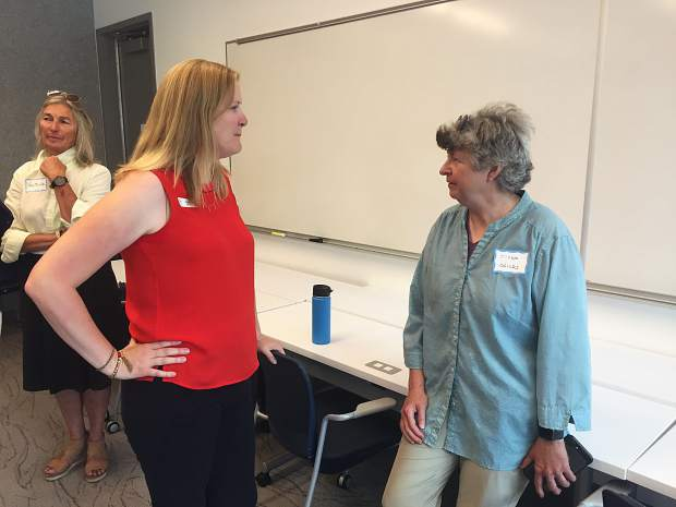 Interim Aspen City Manager Sara Ott and candidate for the full-time position, chats with local resident Ziska Childs during a meet-and-greet with the public on Thursday.