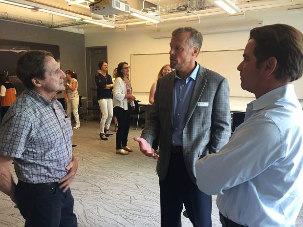 Clockwise: Aspen resident LJ Erspamer speaks with city manager candidate Robb Etnyre and Aspen Mayor Torre during a meet-and-greet with the public on Thursday.