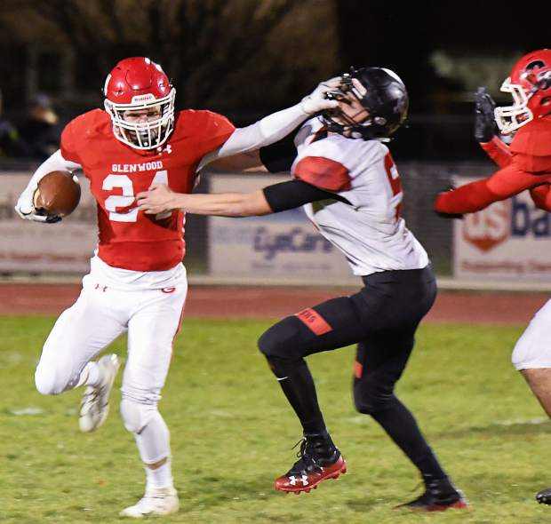 Glenwood Springs Demon Luke Gair escapes a tackle and runs the ball down the field during Friday night's game against the Steamboat Springs Sailors at Stubler Memorial Field.
