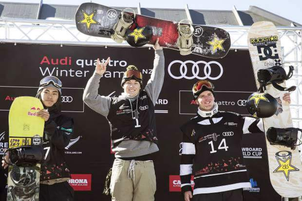 Chris Corning, center, stands atop the podium after a big air event in New Zealand last season.