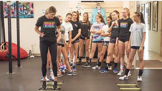Glenwood Springs High School graduate Leah Hinkey shows young athletes how to do a drill at Vibe Volleyball in El Segundo, California.