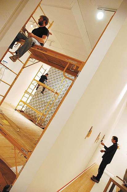 Richard Tuttle, right, prepares instlalltion of his solo show at the Aspen Art Museum in December 2005.