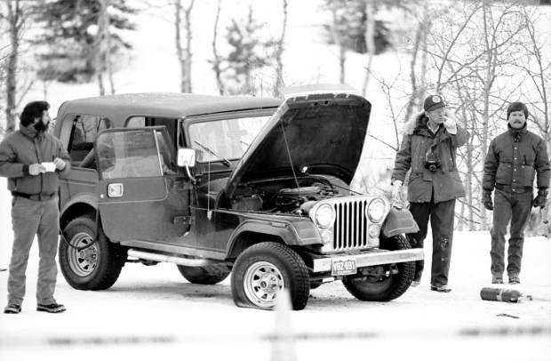 Investigators surround the Jeep that Steve Grabow was killed in by a car bomb outside the Aspen Club on Dec. 8, 1985.