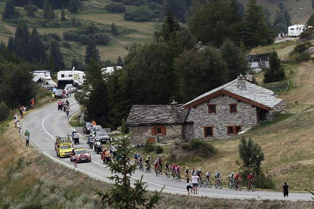 Riders in the breakaway group ride during the nineteenth stage of the Tour de France cycling race over 126,5 kilometers (78,60 miles) with start in Saint Jean De Maurienne and finish in Tignes, France, Friday, July 26, 2019.
