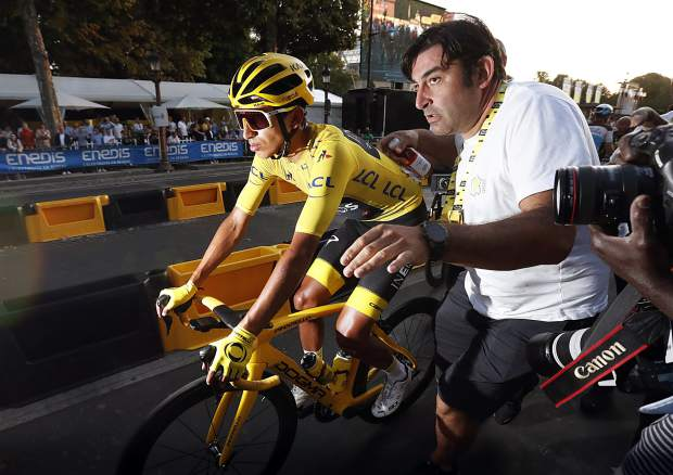 Tour de France winner Colombia's Egan Bernal wearing the overall leader's yellow jersey rides to the podium after the twenty-first stage of the Tour de France cycling race over 128 kilometers (79.53 miles) with start in Rambouillet and finish in Paris, France, Sunday, July 28, 2019.