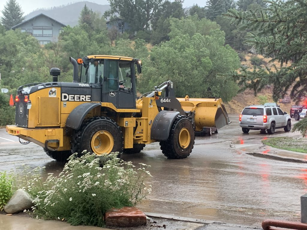 A frontend loader was sent up the Frying Pan Road on Sunday to help clear the mudslides and rescue people trapped by flash flooding on the Lake Christine Fire burn scar.