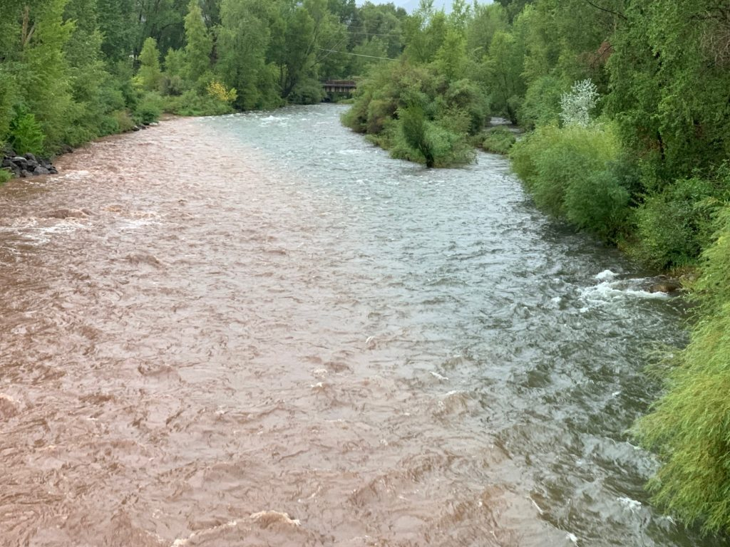 The confluence where the Fryingpan River comes into the Roaring Fork River in Basalt shows a mix of mud and debris from the flash flooding on Basalt Mountain.