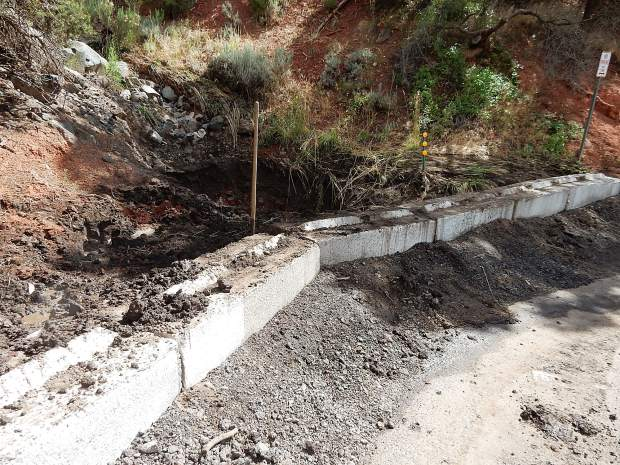 The entrance to a culvert was widened and concrete barriers were placed near the intersection of Pinon and Cedar Drive to catch debris. Water overwhelmed the culvert during Sunday's downpour but it still handled a large share of the rain.