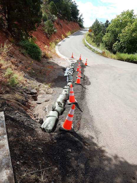 Sandbags are positioned at the intersection of Pinon and Cedar Drive to divert rainwater later in the monsoon cycle.