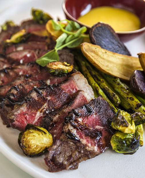 W Aspen executive chef Jackie Siao's menu of international comfort fare includessteak with roasted vegetables