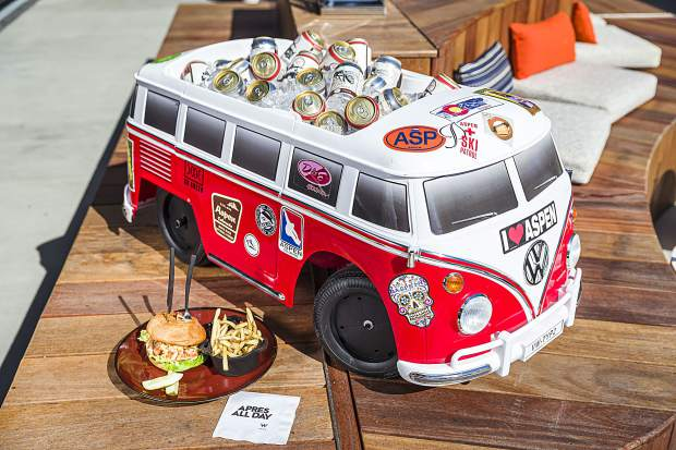 a custom-built VW bus cooler is parked on the Wet Deck rooftop pool bar beside the Fancy Pantsy Burger, awagyu beef patty with two cheeses, maple-pepper bacon, and truffled Béarnaise sauce