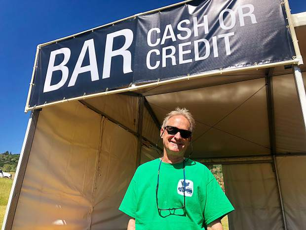 Phil McKeague, a Snowmass local, stands in front of a bar tent set up for the JAS Labor Day Experience music festival. McKeague has helped put on the annual event for 24 years.