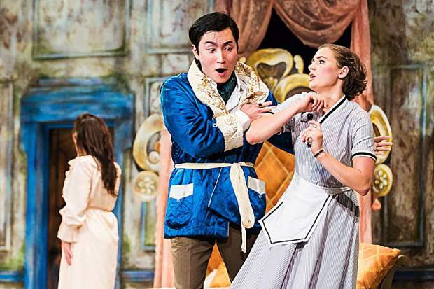 """Xiaomeng Zhang, left, as Count Almaviva grabs the arm of Susanna, played by Jessica Niles, in Aspen Opera Theater's production of Mozart's """"Le Nozze di Figaro"""""""