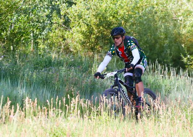 Jim Paussa of Snowmass competes in the Audi Power of Four 25-mile mountain bike race on Saturday, Aug. 17, 2019 in Snowmass. (Photo by Austin Colbert/The Aspen Times)