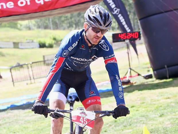 Lakewood's Thomas Herman crosses the finish line to win the Audi Power of Four 50-mile mountain bike race on Saturday, Aug. 17, 2019 in Snowmass. He also won the 2018 race. (Photo by Austin Colbert/The Aspen Times)