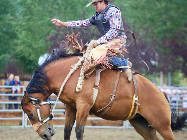 A bronc rider competes at the Snowmass Rodeo on Wednesday, Aug. 7, 2019.